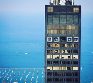 Yep. Those are people in those boxes! 👆 Have you been to the Sky Deck in Willis (Sears) Tower? You can stand on a glass floor and look down on the city) if you aren't afraid! Photo taken by me from a helicopter tour with @vertiporttours ! 🚁 There is so much to see and do in Chicago! Check out my latest post on all the fun things you can do outdoors in Chicago. Link 🔗 in bio!